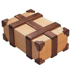 "Kamei Treasure Chest This is one wooden puzzle box you will treasure forever. Reminiscent of an old banded pirate chest, it can be opened in multiple moves. Exquisitely crafted of maple and walnut woods. Measures 6"" x 2-1/2"" x 4"". Solution included. - See more at: http://www.bitsandpieces.com/product/kamei_treasure_chest#sthash.4WBLsmia.dpuf"