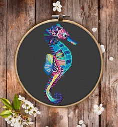 This is modern cross-stitch pattern of Mandala Seahorse for instant download. You will get 7-pages PDF file, which includes: - main picture for your reference; - colorful scheme for cross-stitch; - list of DMC thread colors (instruction and key section); - list of calculated