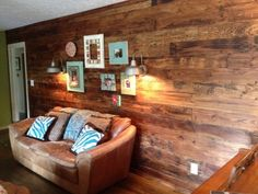 "We got our hands on some old cypress wood beams that were cut and tongue & grooved (by a local mill) to make 6-7"" wide planks.  We covered an old sheet paneling to make an accent wall and add warmth to our room.  The boards were finished with a stain/wax product.  We also added a few old camp lights on the wall to add to the rustic feel.  We loved the way it turned out!"