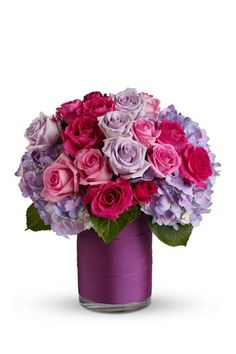Floral Arrangement:  purple hydrangea, pink roses, lavender roses and hot pink roses. DIY with garden picks, silk flowers or store-bought!