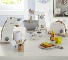 I had a cute kitchen set when I was a little girl. This is awesome. - Pottery Barn Kids Wooden Appliances $34.95 each
