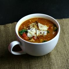 A smoky lentil and roasted vegetable soup with kale.