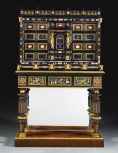 Italian pietre dure mounted pewter inlaid rosewood and ebony cabinet, Roman, mid 17th century, on a George IV gilt-bronze-mounted gonçalo alves stand by Morel and Hughes, circa 1823, mounted with 17th century Florentine pietre dure plaques from the Grand Ducal Workshops