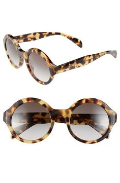 In love with this round light tortoise pair of sunglasses from Prada.