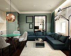 aménagement salon salle à manger très classe - canapé vert émeraude, peinture murale vert sauge et plateau de table jade
