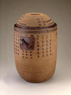 Africa | Lidded basket from the Sara people of Chad | Plant fiber and leather | Mid 20th century || These types of baskets were used for storing grain.