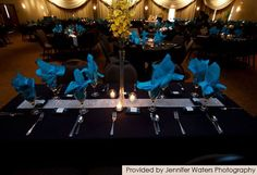 Cute way to tie in the turquoise by using the napkins. Maybe add the pink/white or just pink rose petals around the centerpieces.