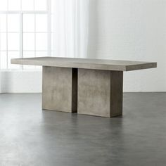 Shop Fuze Stone Indoor-Outdoor Dining Table. A larger take on our Fuze Grey Dining Table. Aggregate of marble, granite, stone and natural fibers cements a sculptural, floating cantilever that reminds us of Wright's Fallingwater. Clear non-toxic wax finish protects.