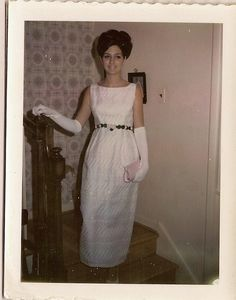 "I've been following Vuguru's/Big Fantastic's Prom Queen...the home of the ""Original McHunkies"". This was me in 1968 getting ready to go to my prom. Yes, all that hair is real ,and I spent 4 hours in a salon getting it washed, rolled, dried, teased, tied ,tucked, twisted, and sprayed into curls. Then I spent the next two nights with my hair wrapped in TP to save the look. This is for Ryan, Chris Mc, Doug, Chris H, Michael, Sam and Danicia's Dad... Take a breath and get ready for the next..."