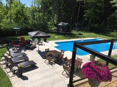 Let's talk about this home's designed for entertaining! In-ground heated private hot tub and concrete patio were added in new pool shed last year. Fully fenced, this area is where the kids will want to be in the summer. Pool Shed, Asphalt Roof Shingles, Lots Of Windows, Waterfront Property, Wood Tree, Heated Pool, New Carpet, Concrete Patio, Cozy Living Rooms