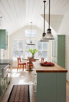 Islands can work in narrower kitchens too if the layout is right. House of Turquoise: Rafe Churchill