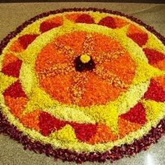 Indian Floral Design - Pookalam is the designation for traditional floral patterns created on the great festival in the South Indian state of Kerala. According to the... Onam Greetings, Rangoli Designs Flower, Onam Celebration, Pookalam Design, Onam Festival, Diwali Festival Of Lights, Local Festivals, Kerala Tourism, Kerala India