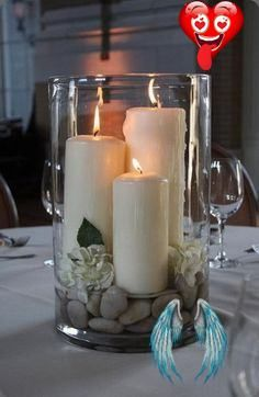 18 Gorgeous Vase Filler Ideas large hurricane vase with candles, rocks and gardenias - centerpiece - bjl<br> You volunteered (or were coerced) to decorate for and upcoming event. Maybe it's a class year-end party, a graduation reception, a baby shower, a wedding shower, or even a wedding. Or maybe you just wanted to bring some style and class into your home. Whatever the case, you needed quick, easy, and budget-friendly decoration ideasread more... Lantern Centerpiece Wedding, Wedding Table Centerpieces, Lantern Wedding, Floating Candles, Diy Candles, Candle Decorations, Wedding Decorations, Design Candles, Decor Wedding