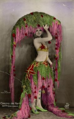 casinodeparis Keeping with the ornamental theme that seems to suit the season, here is a colorized vintage showgirl. Although, now that I look at it again, the green shoes do seem a bit over the top… what do you think? - See more at: http://www.adancersprism.com/category/costume/page/3/#sthash.AvxciHt0.dpuf