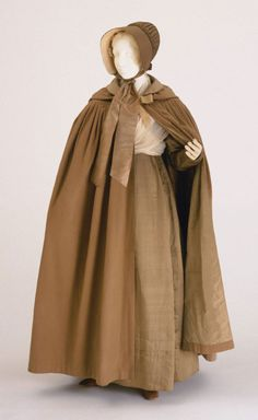 Ensemble for a Quaker Woman (American, circa 1830).  Beige silk satin dress, two fichus (one white silk and one white cotton), cape of light brown wool, beige silk shawl, sheer net cap and beige silk bonnet.  Image and text courtesy Philadelphia Museum of Art.