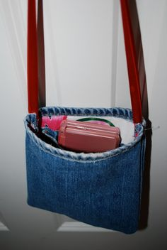 Upcycled jeans purse with ribbon strap and fabric lining. $10.00, via Etsy.