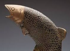 Image result for fish leaping sculpture