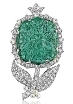 AN EMERALD, PEARL AND DIAMOND FLOWER BROOCH, BY CARTIER.  Christie's.
