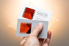 DIY business cards with a space cut out for a photo negative or piece of filmstrip