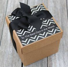 Personalised Gift Box for Fathers Day with your choice of scented candle. Surprise your Man with this fabulous personalised Gift Box, tied with a Luxury Black Grosgrain ribbon and filled with your choice of either one of our 200gm single wick scented candles or a selection of 4 votives. All our candles are handmade in our workshop using Eco Soy Wax, essential oils for perfume and pure cotton wicks.