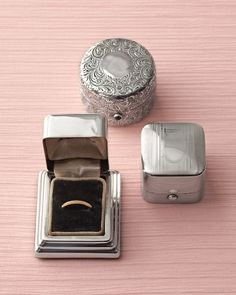 Antique Ring Boxes Pass up the traditional pillow and have your wedding bands carried down the aisle in a gorgeous silver box instead. If you don't already have one from Grandma, look to flea markets, antiques stores, and even eBay. The examples here are from Alice Kwartler Antiques.