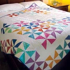 Spring Spin: Bright Pinwheels Lap Quilt Pattern - interesting layout for a pinwheel quilt