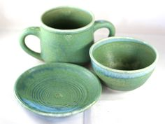 Set of stoneware pottery dishes- two-handled mug, small bowl, and saucer- with green and blue glaze, and heart stamps by CenteredVessel on Etsy