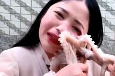 A Chinese vlogger live-streamed herself attempting to eat a live octopus - when the animal latched onto her face and refused to let go, ripping her skin in the process. Largest Sea Creature, Octopus Eating, American Crocodile, First Person Writing, Natural Aloe Vera, Beauty Salon Design, What Is Meant, Beauty Logo, Beauty Hacks Video