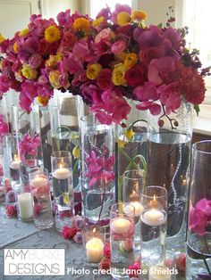 Hot pink, yellow and red color scheme. Beautiful clear vases with summered crystals, orchids, and green embellishments. #modern @janaeshields