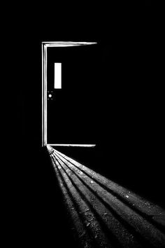 In the Light of Darkness by Evelina Kremsdorf. I love the fact that the light which pierces the darkness comes from an open door. Light And Shadow Photography, Dark Photography, Black And White Photography, Fotografia Tutorial, Dark Drawings, Dark Wallpaper, Monochrom, Chiaroscuro, White Aesthetic