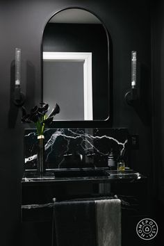 2019 interior design trends - An All black bathroom with black painted walls and a white and black marble pedestal sink. Arched mirror with matching cylinder sconces. Black Marble Bathroom, Modern Bathroom, Black Bathrooms, Luxury Bathrooms, Large Bathrooms, Master Bathroom, Black Bathroom Decor, Bathroom Mirrors, Bedroom Modern