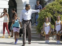 President Barack Obama, with daughter Sasha, arrives to host the White House Easter Egg Roll on the South Lawn of the White House in Washington, Monday, April 25, 2011.