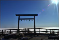 Sacred gate of Shinto, this torii marks the frontier between the impure world and the pure one, between the human world and the Gods domain. Photo taken near Gozaisho Mount, Mie prefecture, Japan