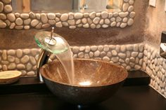 River stones for the backsplash and mirror frame in this awesome room at #theroxbury LOVE IT!