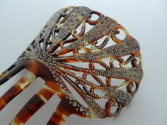 Handcarved Spanish faux tortoisshell celluloid hair comb with metal pique dots and clear paste stones via Etsy