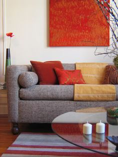 Designer Greta Goss used deep orange and red in this Asian-inspired living room.