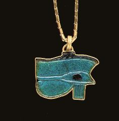 AN EGYPTIAN FAIENCE WADJET-EYE AMULET  LATE PERIOD, DYNASTY XXVI-XXX, 664-343 B.C.