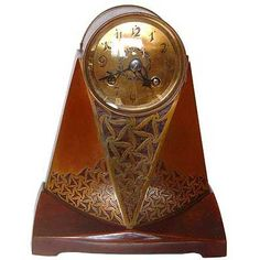 art nouveau brass and rosewood clock by Erhard and Sohne