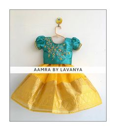 Stunning sunshine yellow color combination kids pattu lehenga and sea green color top. Kids parikini with floral design hand embroidery gold thread work. For details and color customisations please call/whatsapp on 13 April 2019 Girls Frock Design, Kids Frocks Design, Baby Frocks Designs, Baby Dress Design, Kids Dress Wear, Kids Gown, Dresses Kids Girl, Kids Outfits, Baby Dresses