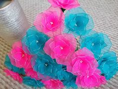 Handmade flowers from nylon stockings. Pink and blue colours.