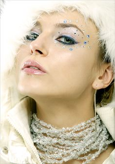 Crystals accent shimmery eye make-up.