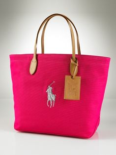 Tan and pink pony Ralph Lauren handbag!! A fun colour in the pink or more sophisticated in the black, this canvas and leather pony tote if finished with metallic thread which is a gorgeous modern accent to a very traditional bag!