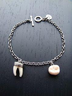 Split wisdom tooth bracelet.