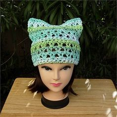 Lightweight Cotton Summer Pussy Cat Hat, Sea Green, Lime Green, Light Blue,  White   Soft 100% cotton multi-color summer lightweight hat with cat ears. I used a high quality cotton yarn thats a great alternative for anyone irritated by man-made fibers.   The color is called Country Stripes and includes white and light blue with various soft shades of green including lime green and sea green. This yarn is matte (no sheen).   As the weather begins to warm up, I thought it would be a good idea…