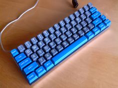 muirium's (DT) custom keyboard right down to the plate/case/layout. The layout is HHKB inspired. R5 sphericals. Soarer's controller fw.