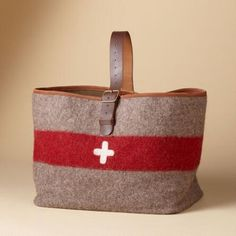 Carry all you need in this appealing vintage Swiss army blanket tote.