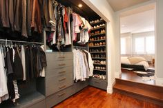 contemporary closet by Hall Developments. open, men's, adjoined to bedroom suite.