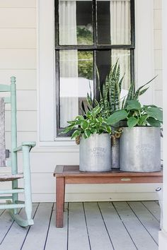 Easy-to-care-for hostas (two kinds) and a snake plant add some life to this front porch styled by Lesley W. Graham. Varied height and varied texture give the display extra visual appeal. See more on The Home Depot Blog.    @lesleywgraham