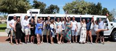 Group of ladies and young men enjoying their Hummer limo Hire Mandurah birthday service.
