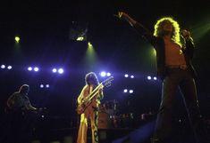Led Zeppelin performing at the Pontiac Silverdome where they played to a record-breaking crowd of 76229 people. Jimmy Page, Robert Plant, Best Rock Bands, Cool Bands, Led Zeppelin Iv, Houses Of The Holy, Music Icon, Rock And Roll, Concert
